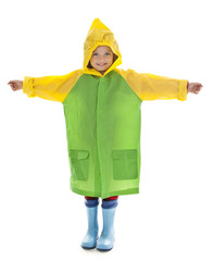 little girl with raincoat and gum boots isolated