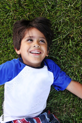 Happy Toddler Child  Playing on the Grass