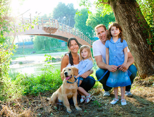Family father mother kids and dog outdoor