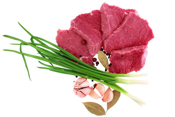 Cut of  beef steak  with  laurel, onion, garlic and  flavouring.