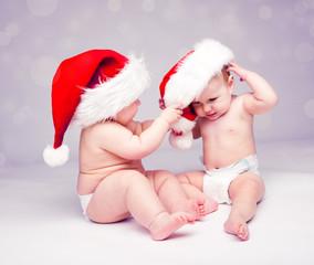 Babies in Santa hats