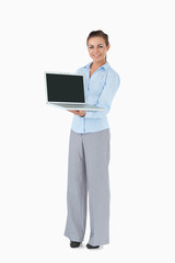Businesswoman with laptop against a white background