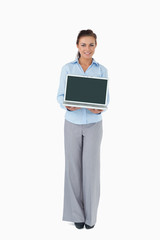 Businesswoman presenting laptop against a white background
