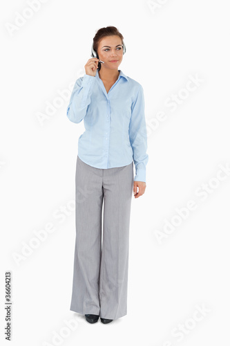 Businesswoman listening to caller with headset on