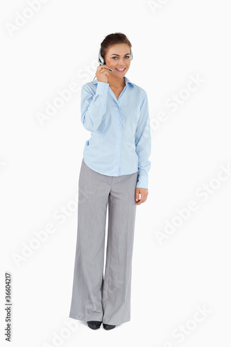 Smiling businesswoman talking with headset on