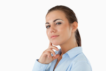 Side view of thinking young businesswoman