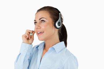 Call center agent looking upwards while talking