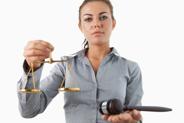 Female lawyer holding scale and gavel