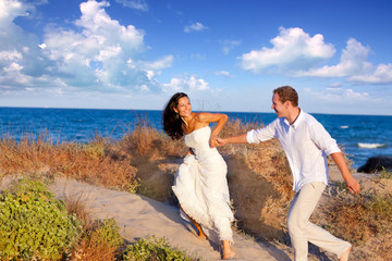 couple in love running at the beach