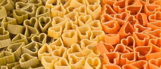 italian flag made from color pasta in shape of heart