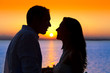 couple sunset profile back light in orange sea