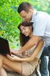 portrait young couple man woman student laptop