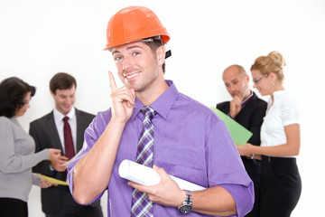 Construction engineer with colleagues in background