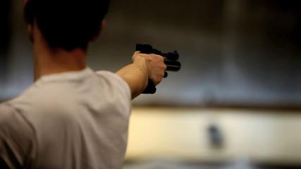 man shoots a gun