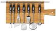 Set kitchen utensils on the chopping board