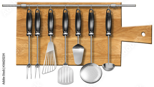 Set kitchen utensils on the chopping board