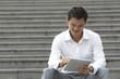 Asian Business man using a Digital Tablet