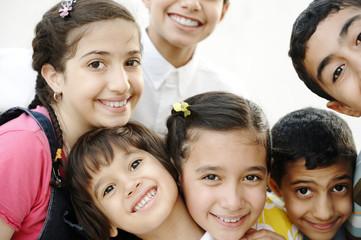 Happy group of children friends together outdoor, portrait