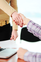 Closing a successful deal with a handshake.