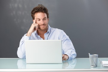 Smiling office worker with computer