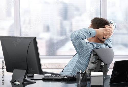 Businessman resting at desk