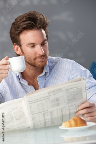 Man with coffee and morning papers