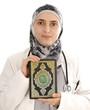 Doctor holding holy book Koran, closeup