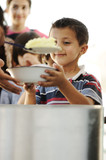 Hungry children in refugee camp humanitarian food