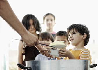 Hungry children in refugee camp, humanitarian food