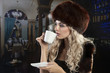 elegant blond girl drinking a cup of tea