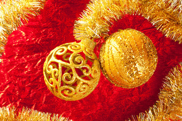 Christmas card golden bauble and tinsel on red