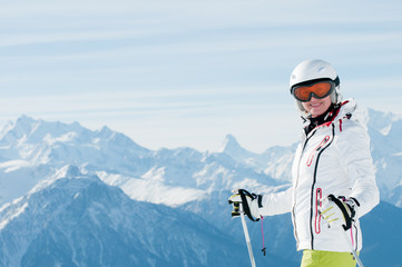 Skiing in Swiss Alps - portrait of female skier
