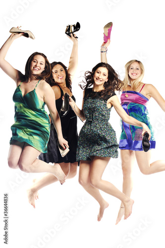 Group portrait of young excited girls jumping