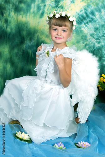 Beautiful girl in white dress with angel wings