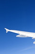 wing of aircraft in clear blue sky - travel concept