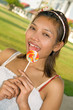 Portrait of beautiful girl with lollipop ..