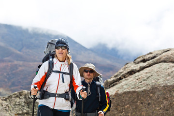 Couple trekking in mountains