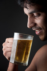 Indian Man drinking beer  from beer mug