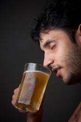 Indian Man drinking beer  from beer mug