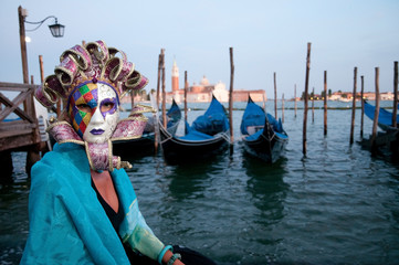 Carnival in Venice - beautiful woman in carnival mask