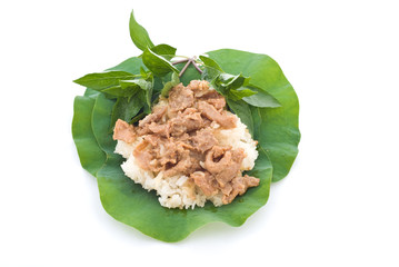 Thai foods, stirred pork with stickyrice on lotus leaf