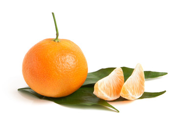 Fresh tangerine with leaves and segments
