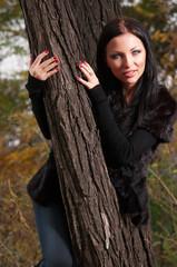 woman standing near a tree