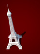 Eiffel Tower in Paris. 3d model on a red background.
