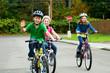 Leinwanddruck Bild - Kids riding bicycles in the street