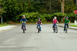 group of kids riding bikes with helmets on