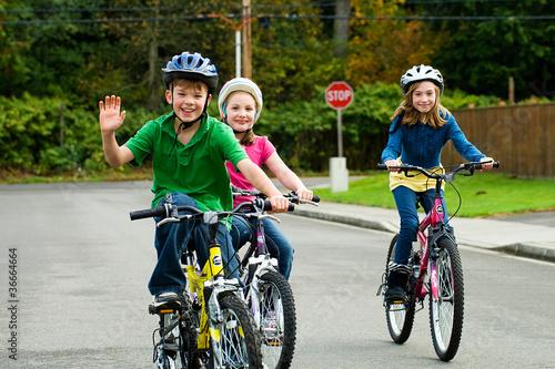 Leinwandbild Motiv Children riding bikes outside