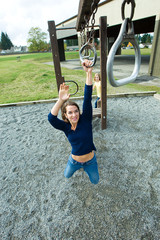 Woman playing at a school playground