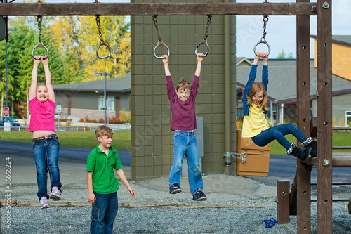 A group of kids playing during recess at school playground