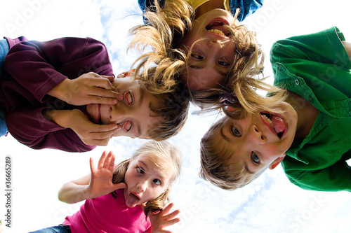 Group of kids looking down